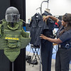 PUPD Officer Tenecia Waddell displays some of the many items necessary to perform the duties of a law enforcement officer. 2015 Indiana Black Expo at the Indianapolis Convention Center and the Downtown Hyatt Regency (Purdue University/ Mark Simons)