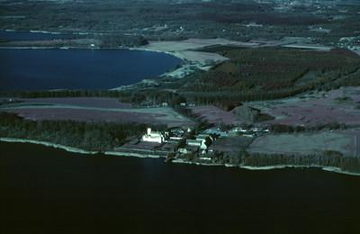 Bosjökloster med Ringsjöarna. Experimentally photographed with infrared film and Kodak Wratten gelatin filter No: 12 & 25 (2 April, 1989). | LH.0363