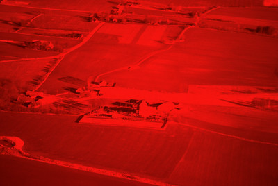 Experimental photography with red filter over landscapes with plantations, agriculture, water and settlements around Vombsjön (9 May, 1986). | LH.0226