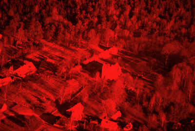 Experimental photography with red filter over landscapes with plantations, agriculture, water and settlements around Vombsjön (9 May, 1986). | LH.0225