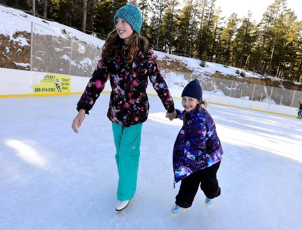 . NEDERLAND, CO JANUARY 6, 2019 Chloe Jentzsch, 11, gives her sister Lilyanna, 6, a hand with turn around the ice at NedRINK in Nederland on Sunday January 6, 2019.  For more photos go to dailycamera.com  (Photo by Paul Aiken/Staff Photographer)