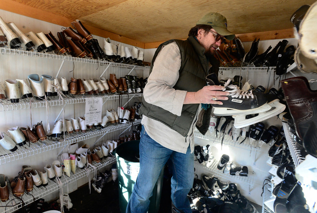 . NEDERLAND, CO JANUARY 6, 2019 Lance Smeltekop, tries to pick out the right skates for a guest at NedRINK in Nederland on Sunday January 6, 2019.  For more photos go to dailycamera.com  (Photo by Paul Aiken/Staff Photographer)