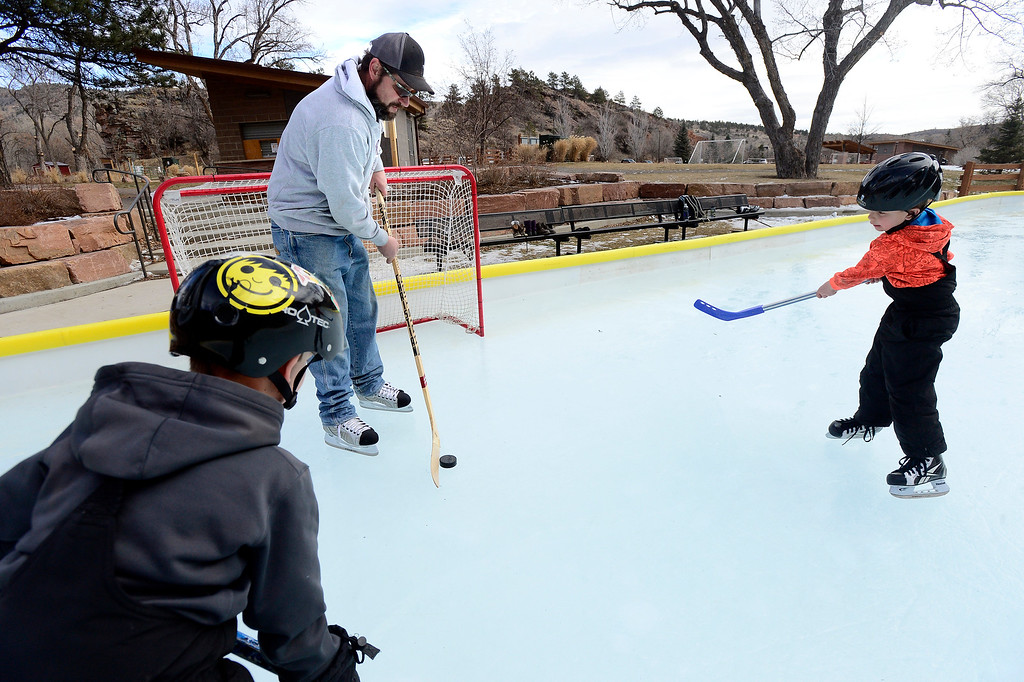 . LYONS , CO JANUARY 6, 2019 Brian Andrews works with his twin sons, Dalton and Colby, 7, at right, on the ice rink at LaVern M. Johnson Park in Lyons on January 6, 2019.  For more photos go to dailycamera.com  (Photo by Paul Aiken/Staff Photographer)