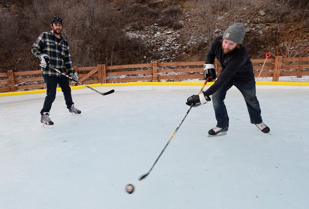 . LYONS , CO JANUARY 6, 2019 Matt Decker, left, and Chris Rudnick practice their ice hockey skills on the ice rink in LaVern M. Johnson Park in Lyons on Sunday January 6, 2019.  For more photos go to dailycamera.com  (Photo by Paul Aiken/Staff Photographer)