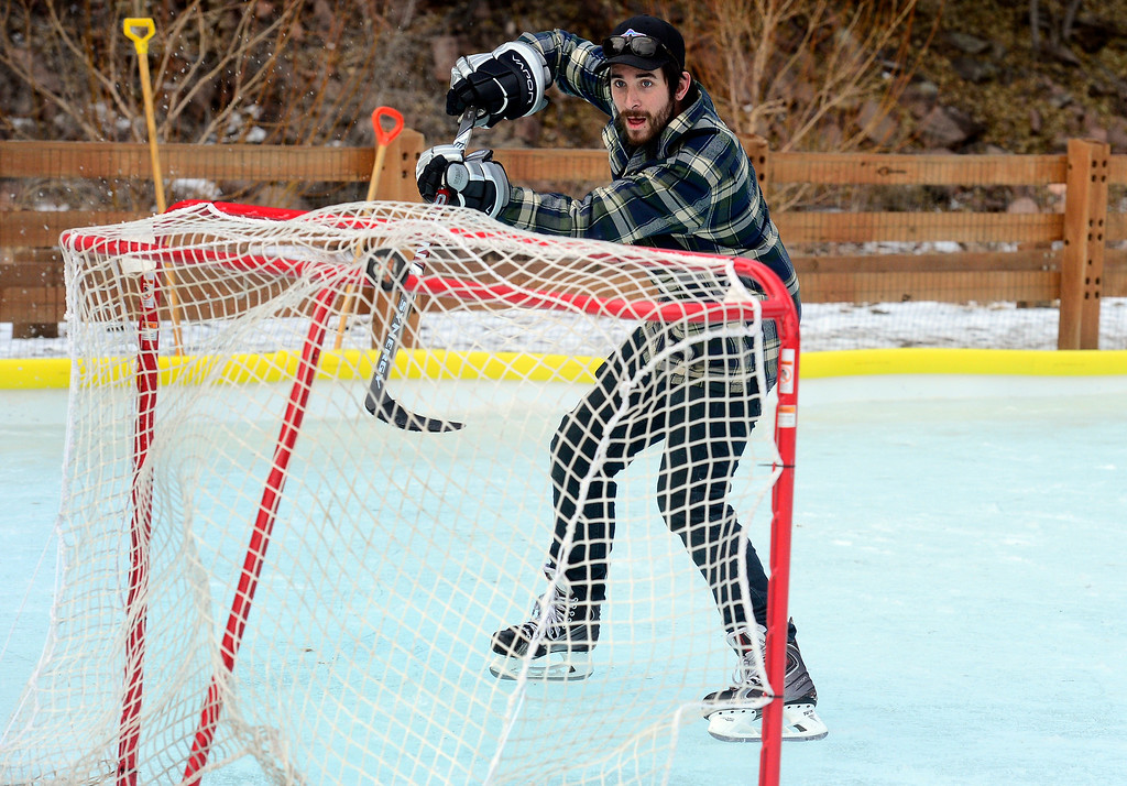 . LYONS , CO JANUARY 6, 2019 Matt Decker takes a shot on the net while practicing his ice hockey skills on the ice rink in LaVern M. Johnson Park in Lyons on Sunday January 6, 2019.  For more photos go to dailycamera.com  (Photo by Paul Aiken/Staff Photographer)