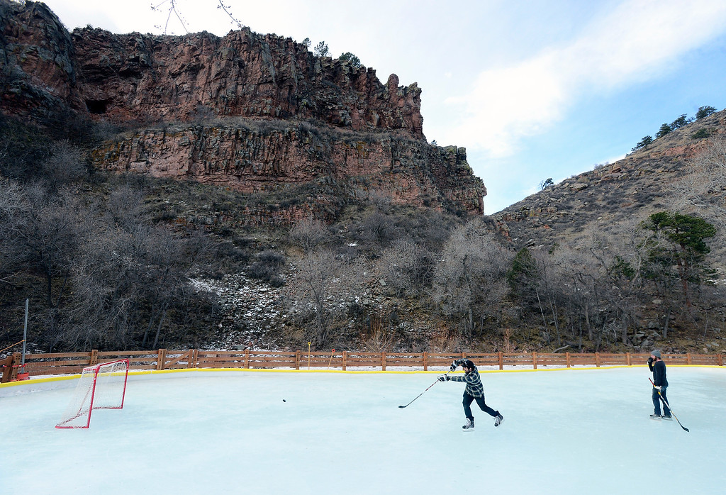 . LYONS , CO JANUARY 6, 2019 Matt Decker, left, and Chris Rudnick take turns shooting on the net while practicing their ice hockey skills on the ice rink in LaVern M. Johnson Park in Lyons on Sunday January 6, 2019.  For more photos go to dailycamera.com  (Photo by Paul Aiken/Staff Photographer)