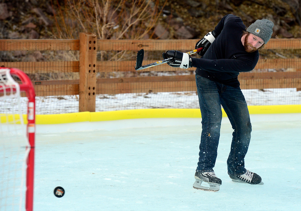 . LYONS , CO JANUARY 6, 2019 Chris Rudnick takes a shot on the net while practicing his ice hockey skills on the ice rink in LaVern M. Johnson Park in Lyons on Sunday January 6, 2019.  For more photos go to dailycamera.com  (Photo by Paul Aiken/Staff Photographer)