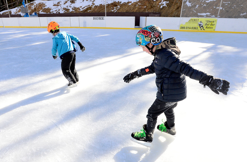 . NEDERLAND, CO JANUARY 6, 2019 Henry Schliff, 7, and Ezzilin Murton Amato, 8, chase each other around the ice at NedRINK in Nederland on January 6, 2019.  For more photos go to dailycamera.com  (Photo by Paul Aiken/Staff Photographer)