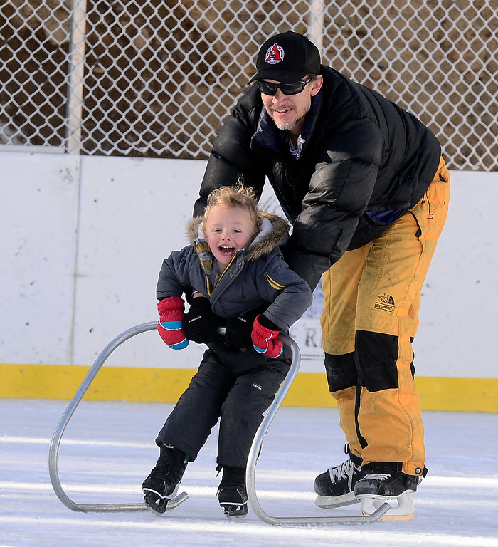 . NEDERLAND, CO JANUARY 6, 2019 Nicholas Jentzsch gives his son Ethan, 3, a trip around the ice at NedRINK in Nederland on Sunday January 6, 2019.  For more photos go to dailycamera.com  (Photo by Paul Aiken/Staff Photographer)