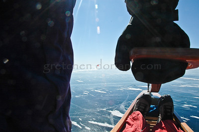 Chris Clark, giving me a ride   (my feet - his leg & hand) to get 2 miles offshore of Marinette, WI | Menominee, MI to the Race Course