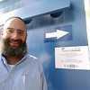 Shmuel Bowman, OL Executive Director in front of ICEJ Germany plaque