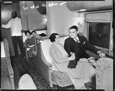 sleeping car with people posing--no location