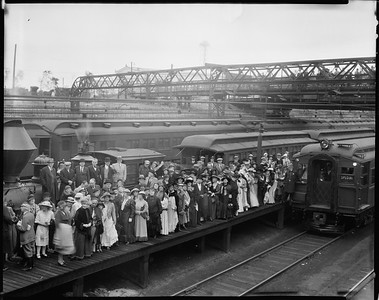 steam locomotive 201 and electric commuter car with people posing on platform--Chicago IL