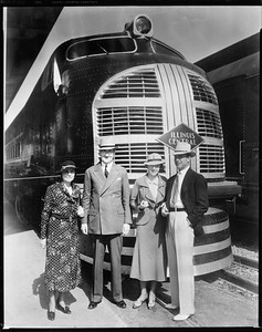 diesel locomotive with people posing--no location