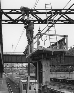 2010.030.PC05.06--lee hastman collection 8x10 print--ICRR--Co Photo view of workers maintaining catendary at 12th Street commuter station--Chicago IL--no date