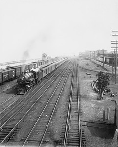 2010.030.PC07.14--lee hastman collection 8x10 print--ICRR--Co Photo view of steam locomotive 4-4-2 2964 on northbound passenger train at 43rd Street--Chicago IL--no date