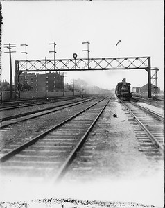 2010.030.PC07.12--lee hastman collection 8x10 print--ICRR--Co Photo view of steam locomotive 1413 on commuter passenger train at 39th Street--Chicago IL--no date