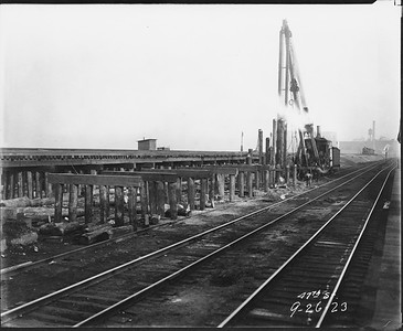2010.030.PC07.25--lee hastman collection 8x10 print--ICRR--Co Photo view of pile driver at work for track elevation at 47th Street--Chicago IL--1923 0926