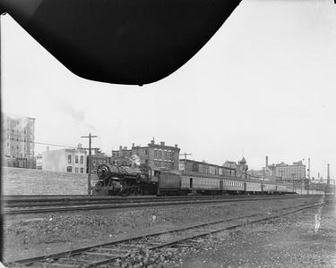 2010.030.PC07.09A--lee hastman collection 8x10 print--ICRR--Co Photo view of steam locomotive 4-6-2 1050 on southbound steel passenger train at 31st St--Chicago IL--no date