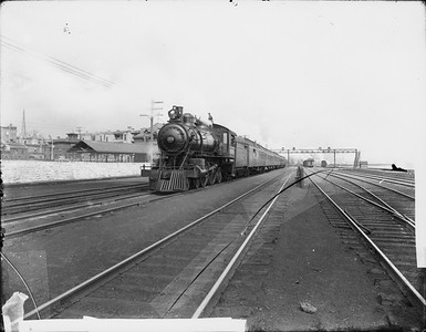 2010.030.PC07.01A--lee hastman collection 8x10 print--ICRR--Co Photo view of steam locomotive 4-4-2 1006 on southbound passenger train at 22nd Street--Chicago IL--