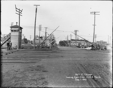 2010.030.PC12.02--lee hastman collection 8x10 print--ICRR--Co Photo view of grade crossing and gates at 76th Street looking east--Grand Crossing IL--1902 0901