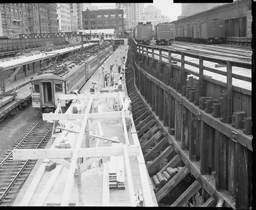 2010.030.PC03.15--lee hastman collection 8x10 print--ICRR--Co Photo view of construction at Randolph Street station with CSS&SB interurban train--Chicago IL--no date