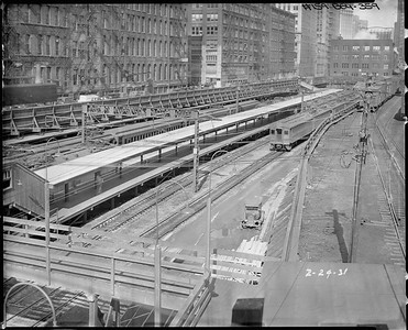 2010.030.PC03.16--lee hastman collection 8x10 print--ICRR--Co Photo view of Randolph Street station with CSS&SB interurban passenger train--Chicago IL--1931 0224