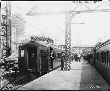 2010.030.PC03.22--lee hastman collection 8x10 print--ICRR--Co Photo view of Randolph Street station with electric commuter passenger trains at platforms--Chicago IL--1926 0700