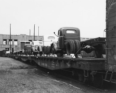 2010.030.PC02.14A--lee hastman collection 8x10 print--ICRR--Co Photo view of trucks on flatcars at Congress Street yard--Chicago IL--1947 0000