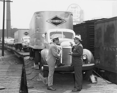 2010.030.PC02.14C--lee hastman collection 8x10 print--ICRR--Co Photo view of trucks on flatcars at Congress Street yard--Chicago IL--1947 0000