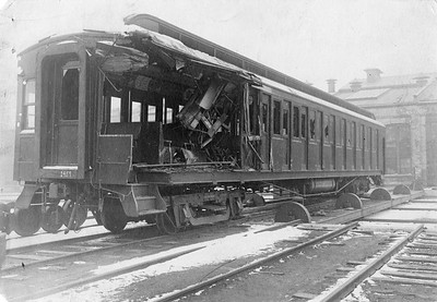 2010.030.PC22.14A--lee hastman collection 8x10 print--ICRR--Co Photo view of wrecked wooden commuter coach 1429 at Burnside--Chicago IL--no date