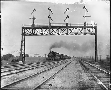 2010.030.PC20.034--lee hastman collection 8x10 print--ICRR--Co Photo view of steam locomotive 2-4-6T 1424 with passenger train--south of Flossmoor IL--no date