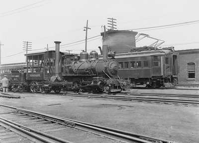2010.030.PC20.000B--lee hastman collection 8x10 print--ICRR--Co Photo view of steam locomotive 0-4-0 1 Mississippi 2-4-4T 489 electric commuter coach at 27th Street--Chicago IL--1926 0700