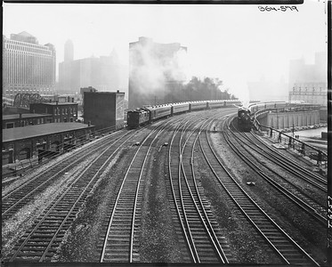 2010.030.PC24.06--lee hastman collection 8x10 print--C&NW--boxcab oil-electric locomotive switching passenger cars at Kinzie and Clinton Street scene--Chicago IL--no date--