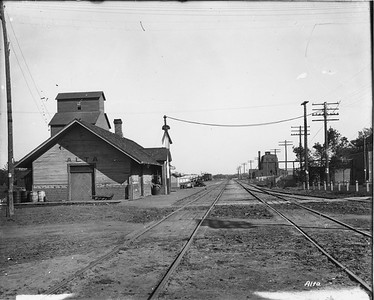 2010.030.PC13.00--lee hastman collection 8x10 print--ICRR--Company Photograph view of depot scene--Alta IA--no date