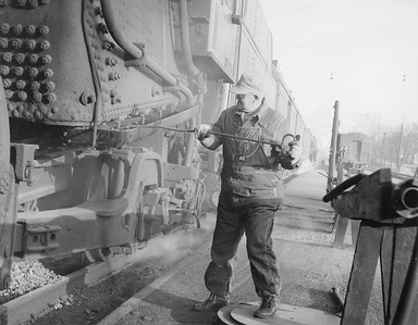2010.030.PC17.09--lee hastman collection 8x10 print--ICRR--Co Photo view of hostler cleaning ashpan on steam locomotive--Paducah KY--no date