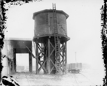 2010.030.PC16.01--lee hastman collection 8x10 print--ICRR--Co Photo view of water tank--Aberdeen MS--1917 1119