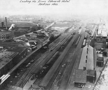 2010.030.PC16.18--lee hastman collection 8x10 print--ICRR--Co Photo view of depot station and platforms and yards before track elevation--Jackson MS--1925 0403
