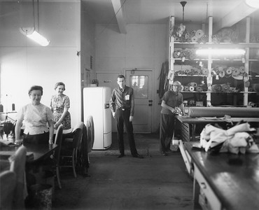 2010.030.PC30.16--lee hastman collection 8x10 print--ICRR--Co Photo view of sewing room at Burnside shops--Chicago (Burnside) IL--1969 1000. Left to right: seamstresses Josephine and Caroline; foreman Frank Roessler, and Stanley.