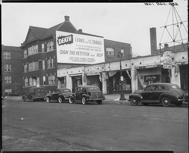 2010.030.PC09.13--lee hastman collection 8x10 print--ICRR--Co Photo view safety billboard scene near Bryn Mawr station--Chicago IL--no date