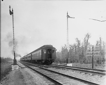 2010.030.PC29.17--lee hastman collection 8x10 print--ICRR--Co Photo view of hind end of passenger train actionsteam locomotive 4-4-2 1010 on passenger train action scene--location unknown--no date