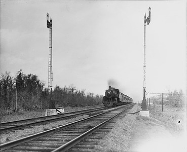 2010.030.PC29.16--lee hastman collection 8x10 print--ICRR--Co Photo view of steam locomotive 4-6-2 1125 on passenger train action scene--location unknown--no date