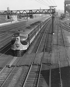 2010.030.PC29.14--lee hastman collection 8x10 print--ICRR--Co Photo view of EMD diesel locomotive 4025 on passenger train near 27th Street--Chicago IL--no date