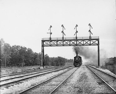 2010.030.PC29.15--lee hastman collection 8x10 print--ICRR--Co Photo view of steam locomotive 4-4-2 1010 on passenger train action scene--location unknown--no date
