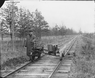 2010.030.PC25.02--lee hastman collection 8x10 print--ICRR--Co Photo view of old track speeder--location unknown--no date