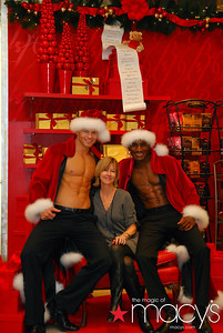 Photos taken of Macy's customers posing with the sexy Santas.  Taken at the Fashion Show Macy's, Las Vegas, NV.