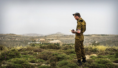IDF soldier in prayer in the Judean Hills