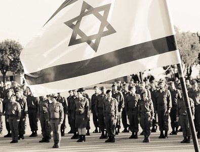 IDF soldiers with flag flying high