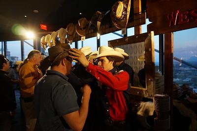 Custom cowboy hat fittings at IETF 92 in Dallas, Texas.