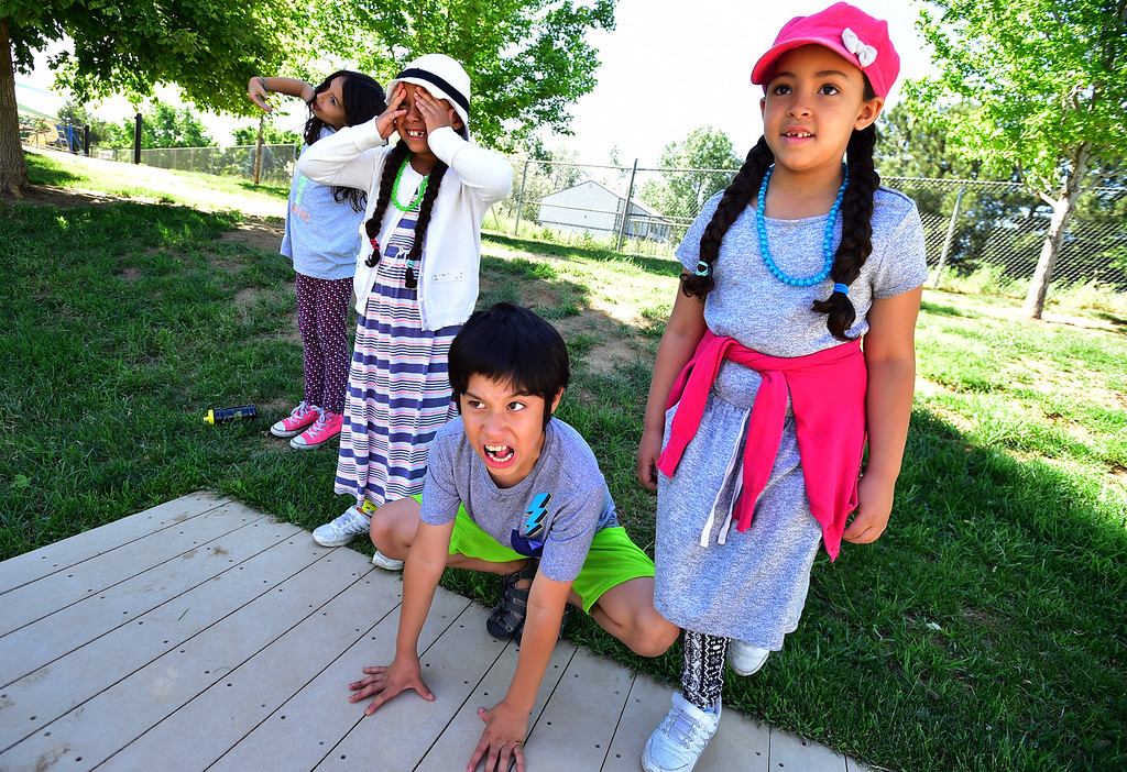 . From left to right, Odalis Torres, Sara Marzak, Jaziel Morquecha and Cailynn Slepply play a theatrical scene where they play ferocious animals of the jungle during the I Have A Dream summer STEM conference at Peak to Peak Charter School in Lafayette on Thursday.  For more photos go to dailycamera.com Paul Aiken Staff Photographer June 7, 2018